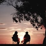 Couple outside looking at sunset