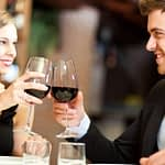 couple eating in a restaurant toasting wine