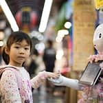 girl-holding-hands-with-cute-robot