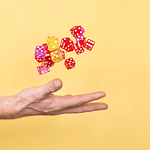 a hand throwing dice in the air as if to suggest speculation not investing