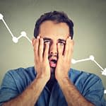 frustrated stressed man desperate with financial market graphic going down