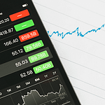 iPhone display showing stock quotes investing