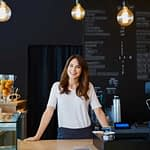 Woman small business owner at counter