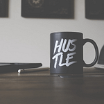 Hustle-mug-on-desk