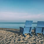 Blue beach chairs at ocean