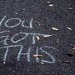 "Chalk on sidewalk says ""You Got This"""