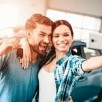 A Man And A Woman Do Selfie Near Their New Car.