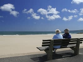retired-couple-on-beach-bench