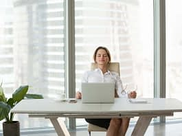 Young businesswoman relaxing leaning on comfortable ergonomic chair in office