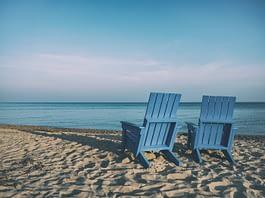 Blue beach chairs at ocean