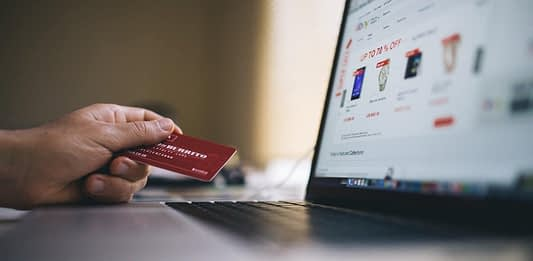 person using credit card to shop online