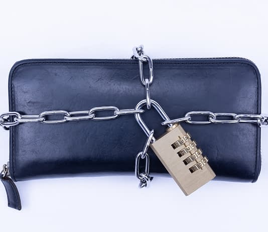 A wallet which is tied up with a chain.