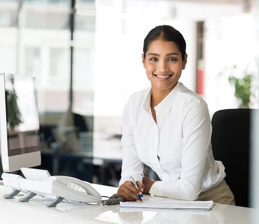 Cheerful woman in office